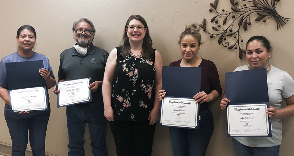 Jaime Tidwell Foster, VP of Business Development, with parents of the 2020 Student Scholarship Awards from Woodmont Cabinetry